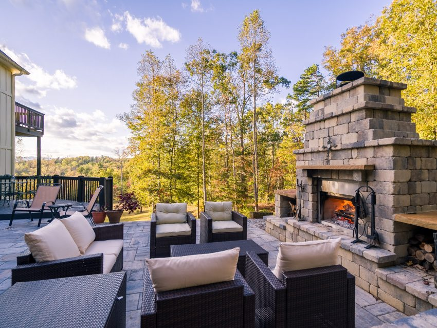 Outdoor patio fireplace entertainment space in the summer